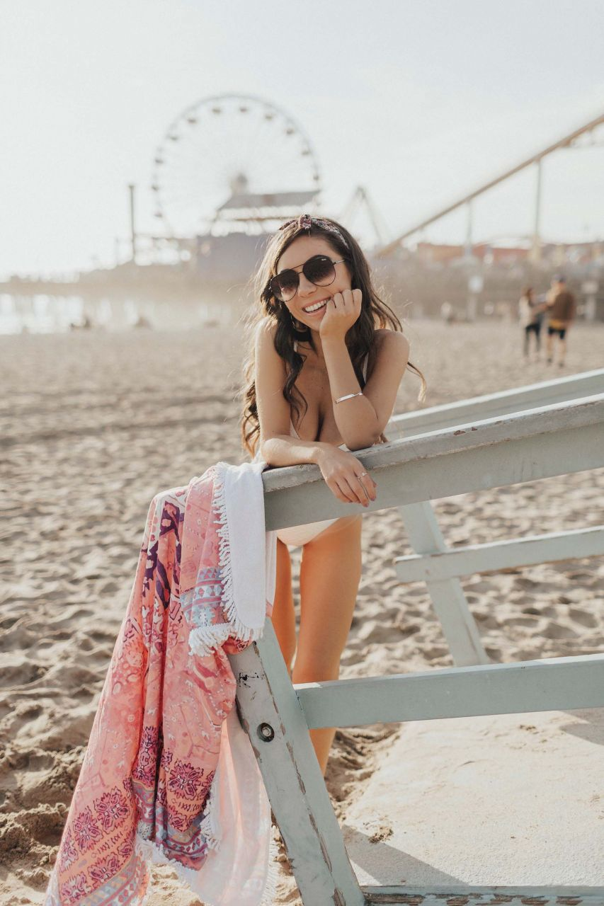 Nihan_Gorkem_style_with_nihan_river_island_white_knot_front_cutout__one_piece_swimsuit_quay_black_aviators_santa_monica_pier_ferris_wheel_pacific_park.jpg