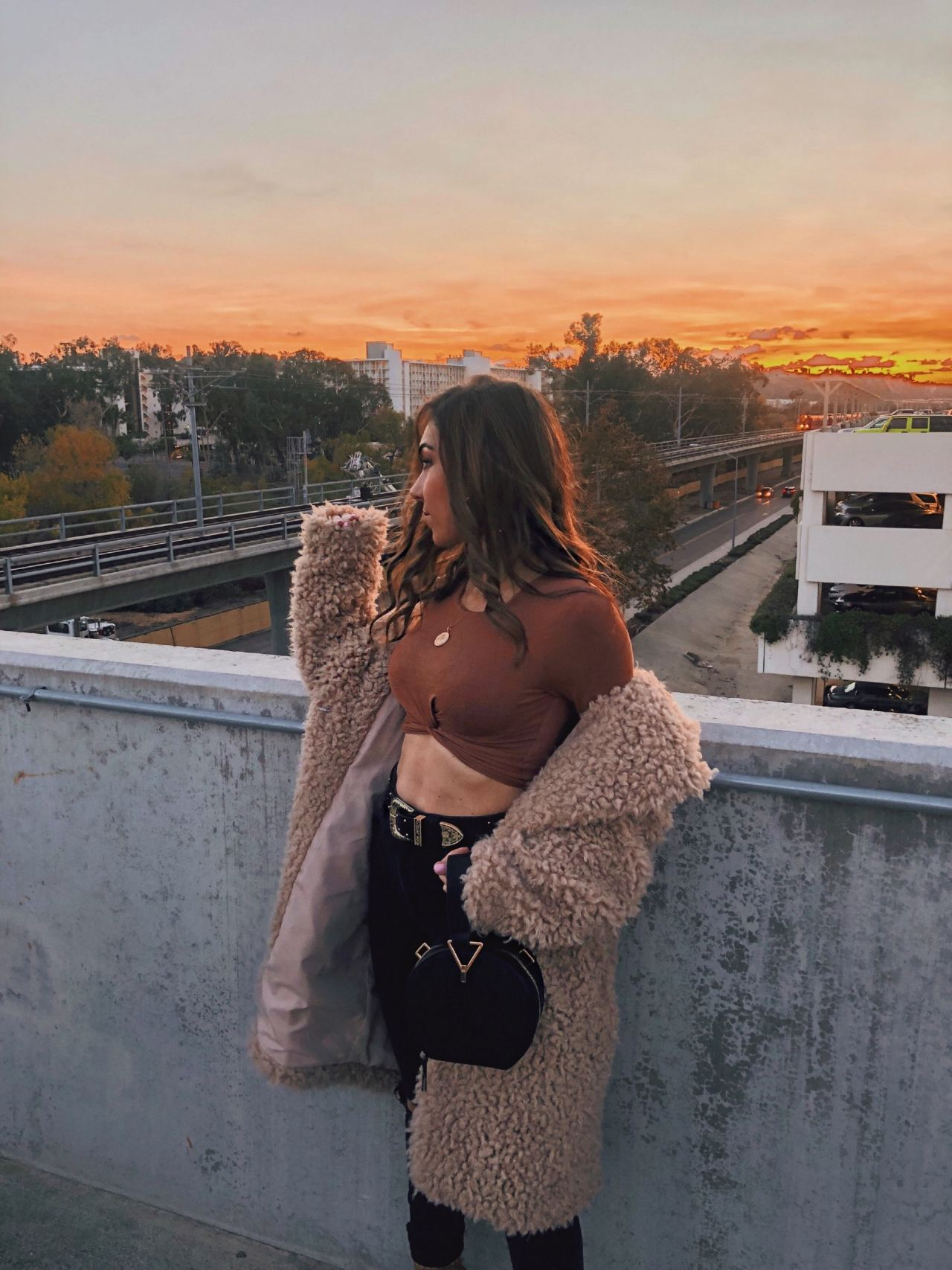 Style_with_Nihan_Circle_Bag_Trend_Mango_metal_handle_circle_bag_Revolve_fuzzy_coat_crop_top_Fashion_Valley_San Diego
