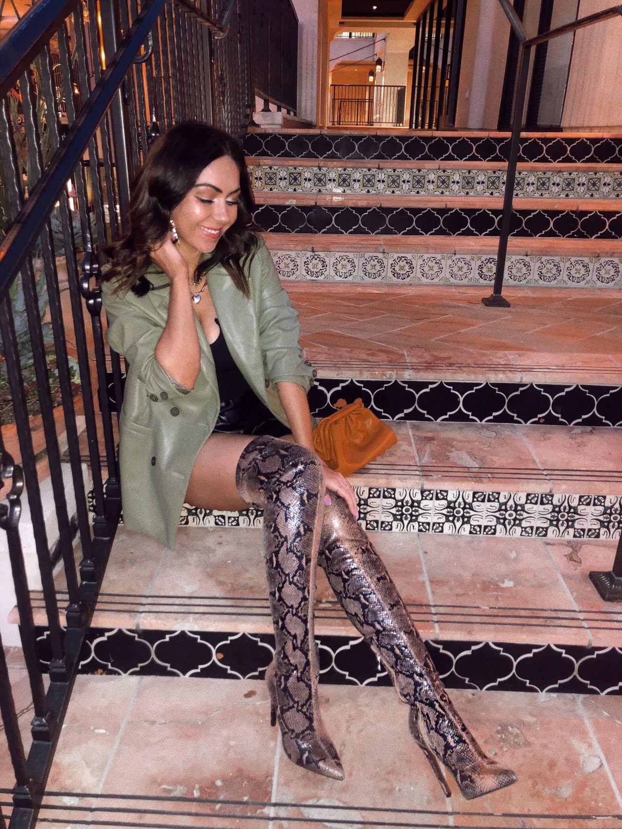 Style Blogger Nihan Gorkem wearing snake print thigh high boots