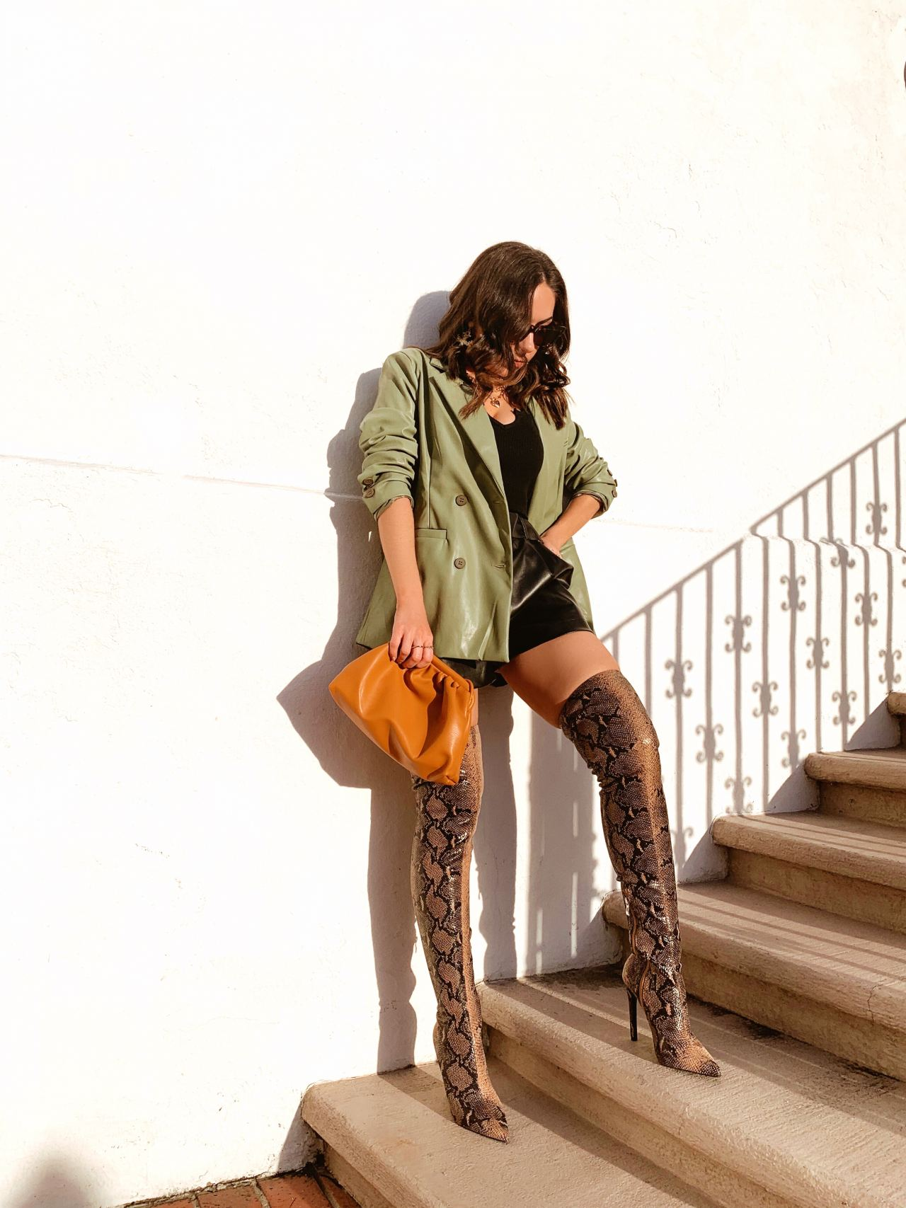 Style with Nihan wearing snake print boots and blazer